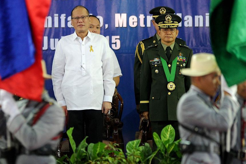 Philippine President Benigno Aquino (back left) with incoming army chief Major General Eduardo Ano (back right) during a handover ceremony in Manila on July 15, 2015.