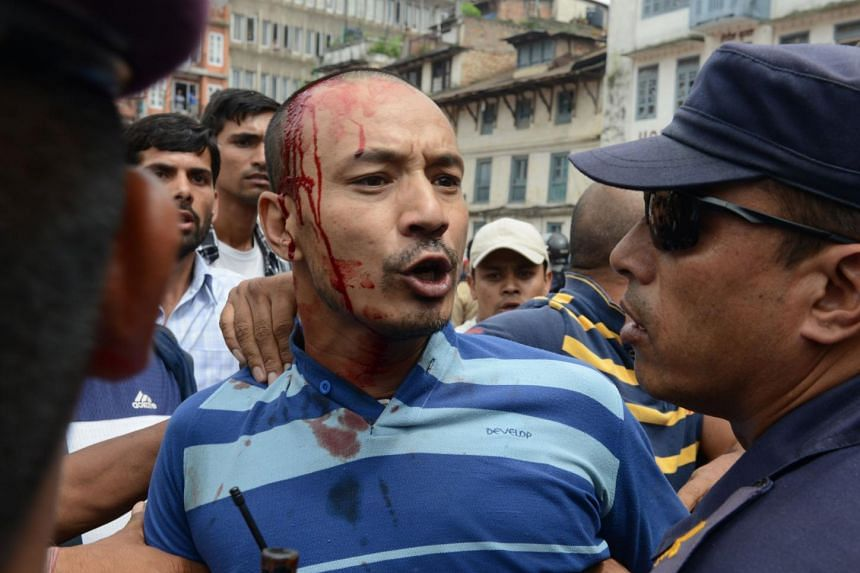 Nepalese police clash with activists campaigning for the country to be declared a Hindu state in Kathmandu.