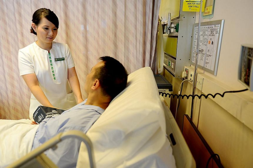 Ms Nur Faridah Mohd Mokhtar, senior staff nurse at Singapore General Hospital (SGH) attending to the needs of a patient.
