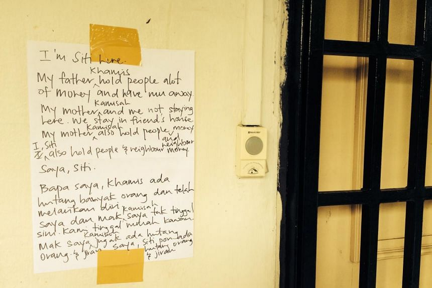 """A note, by """"Siti"""", was pasted near the door. It said that Siti and her mother no longer lived in the flat."""