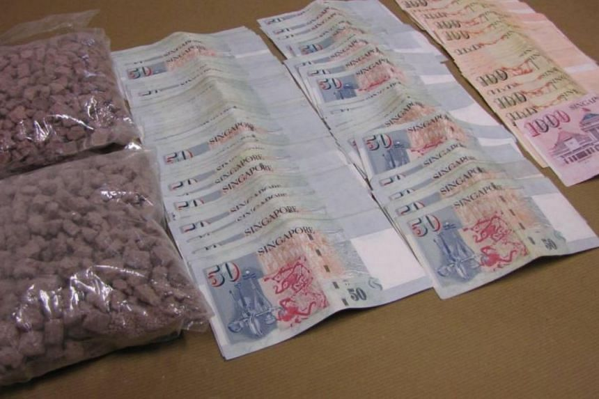 Heroin and cash seized during the operation.