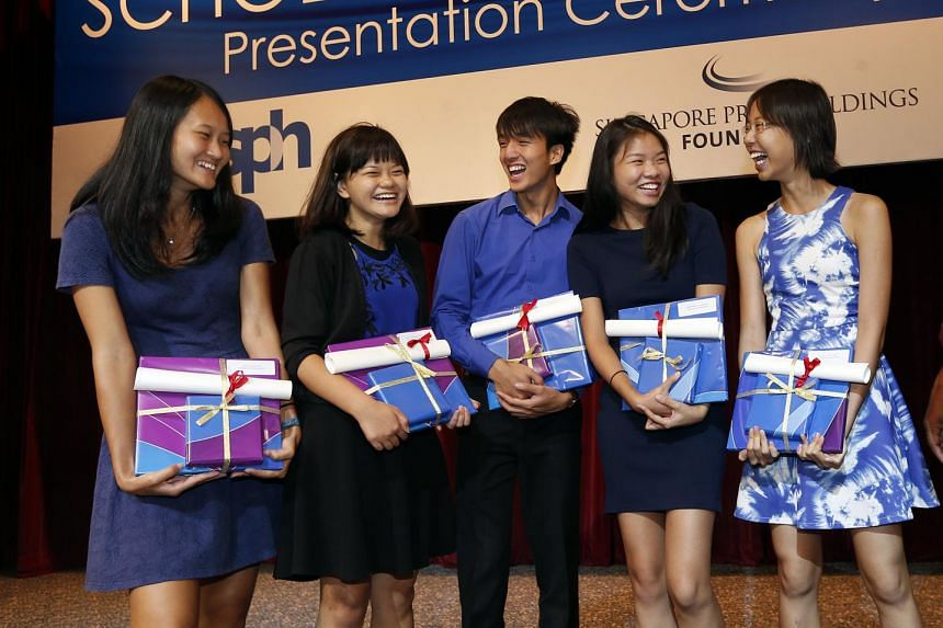 The SPH journalism scholarship recipients are (from left) Ms Jean Lau, 20; Ms Prisca Ang, 19; Mr Yap Jun Weng, 21; Ms Charmaine Ng, 22; and Ms Clara Chong, 19. Ms Chong, who is a sports intern reporter with The Straits Times, said she is looking forward t