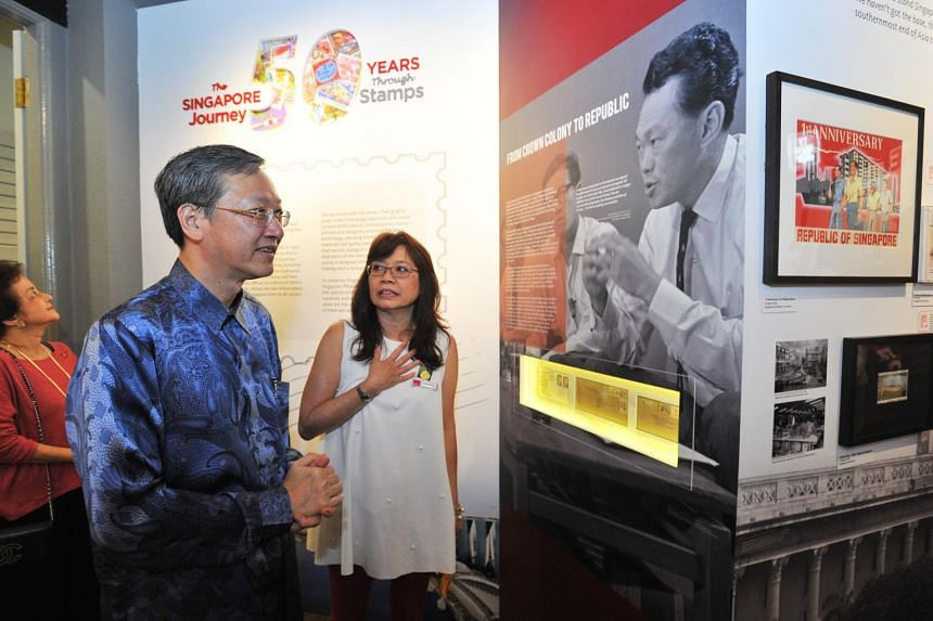 Minister of State for Culture, Community and Youth Sam Tan (left) touring the new exhibition with Singapore Philatelic Museum senior curator Lucille Yap.