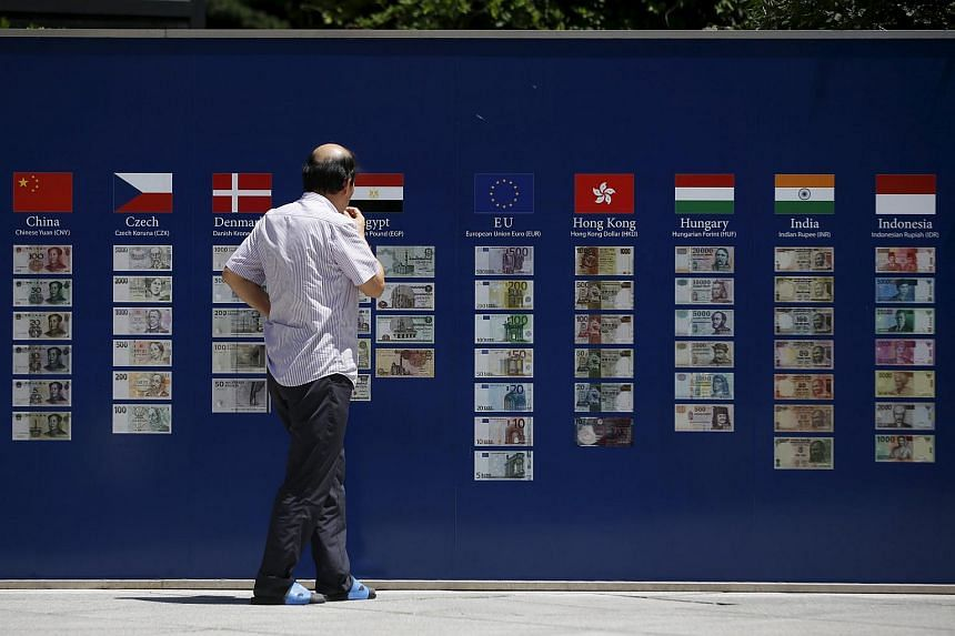 Banknotes from various countries including the euro (centre) in Seoul, South Korea.