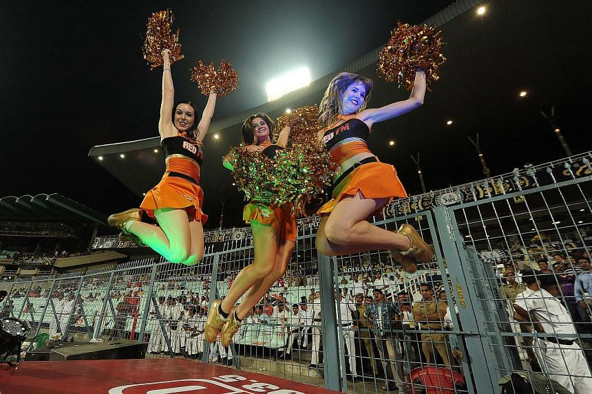 Sunrisers Hyderabad cheer leaders perform during an IPL 2015 match at the Eden Gardens in Kolkata, on May 4, 2015.