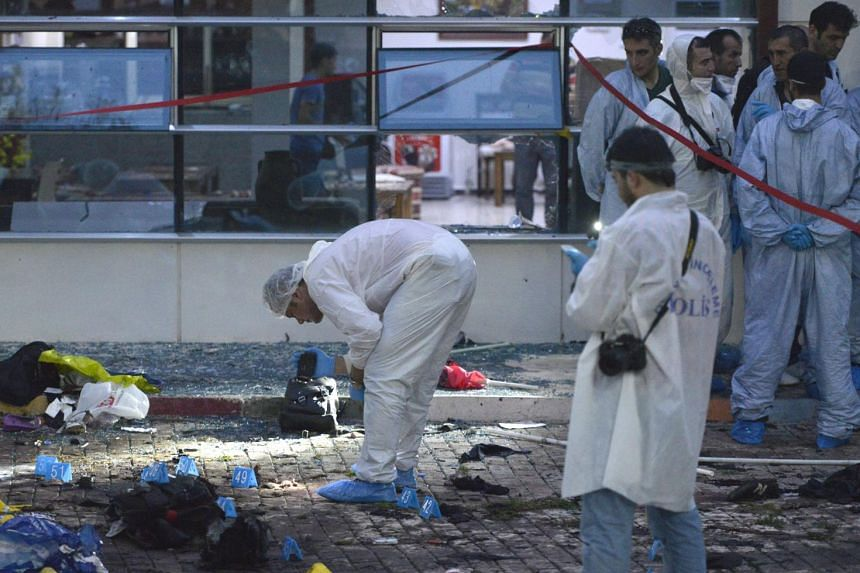Turkish police searching the area after a bomb attack ripped through the cultural centre in Suruc.