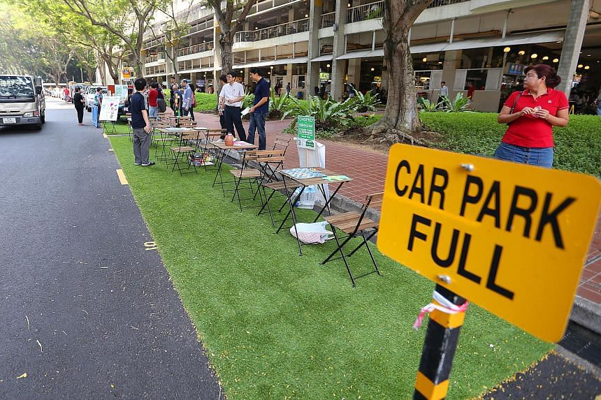 """A """"carpark full"""" sign was placed at some parking lots."""