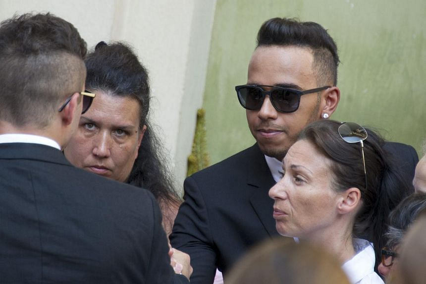 British Formula One racing driver Lewis Hamilton (second from right) attends the furneral of late French Formula 1 driver Jules Bianchi' at the Cathedrale Sainte Reparate in Nice, France, on July 21, 2015.