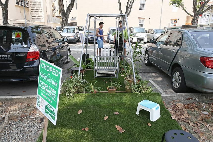 """A swing and potted plants installed at a """"park"""" in Jalan Besar."""