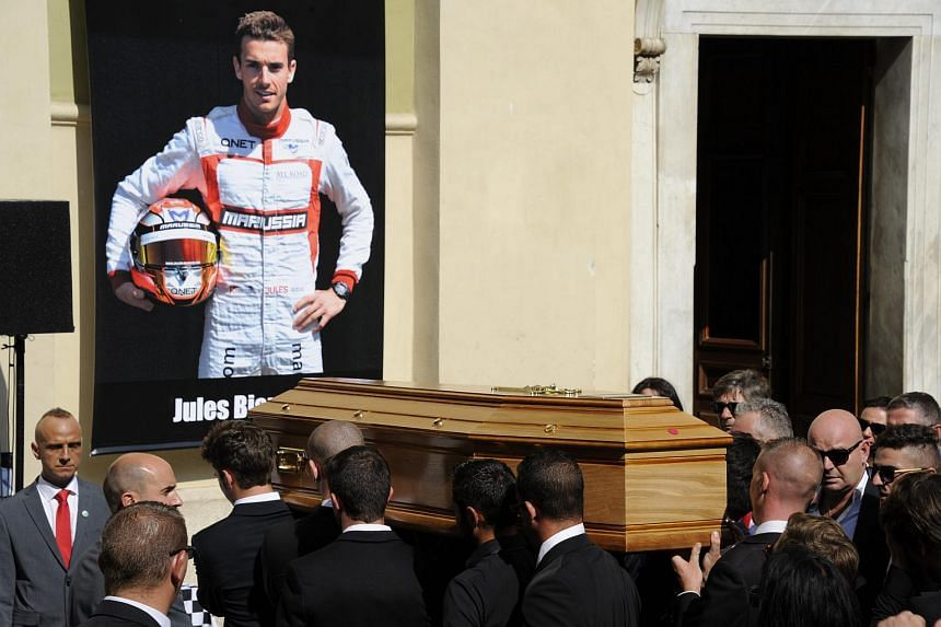 Pallbearers carry the coffin of French Formula One driver Jules Bianchi during the funeral held at the Cathedral of Sainte Reparate, in Nice, France, on July 21, 2015.