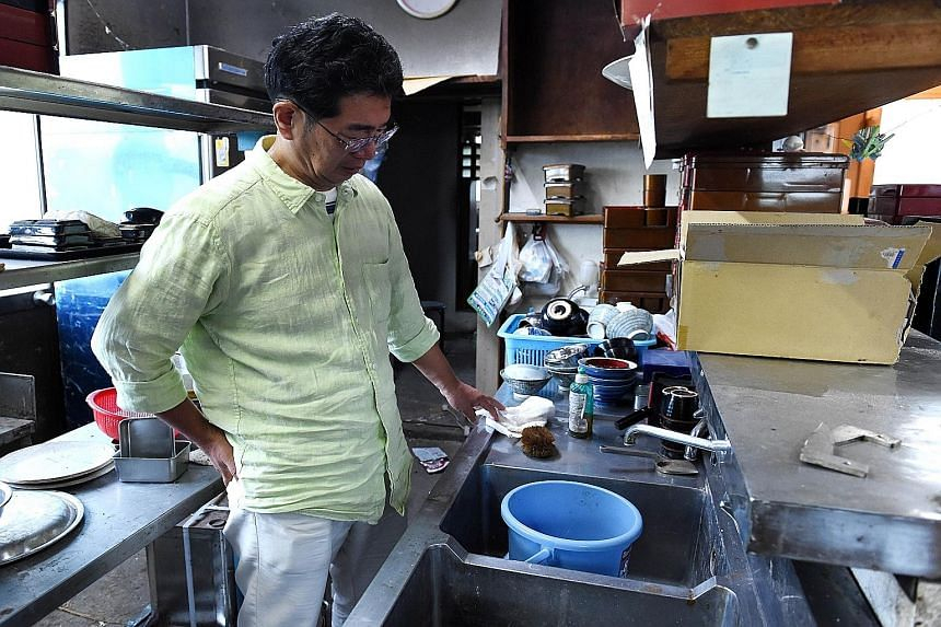 Mr Satoru Yamauchi, 60, in his abandoned noodle restaurant in Naraha, a tiny town in Fukushima prefecture.