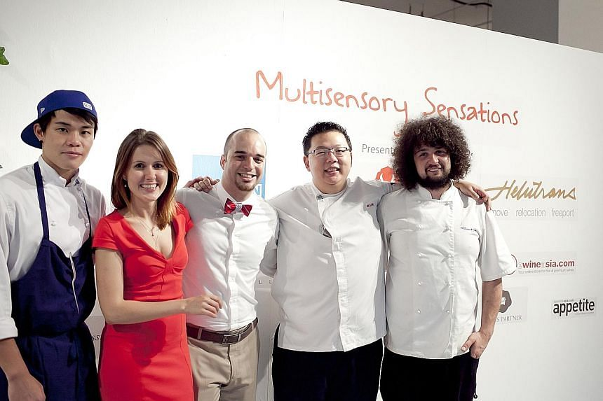 Ms Maria Kuvshinova with her Clubvivre co-founder Andries de Vos (in bow tie) and some of the chefs of their start-up. She says companies with global aspirations that want to start out in Asia should look to Singapore first.