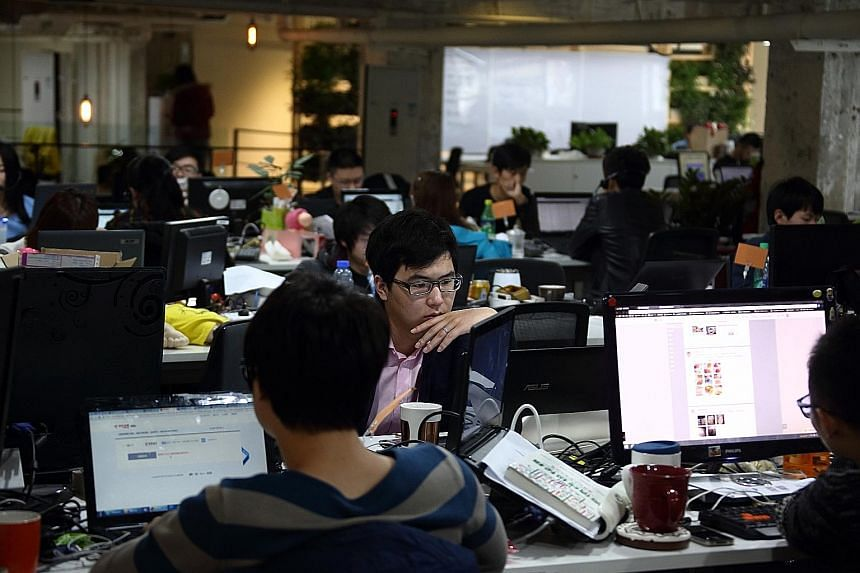 """Chinese workers at Tech Temple, a co-working space for start-up firms in Beijing. China is the second-biggest start-up market and the leading """"mobile-first"""" market in the world, says Mr William Bao Bean, partner at global accelerator programme SOS Ve"""