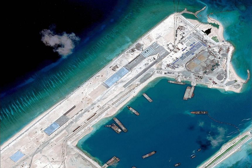 An April satellite image of what is claimed to be an airstrip under construction on Fiery Cross Reef in the South China Sea.