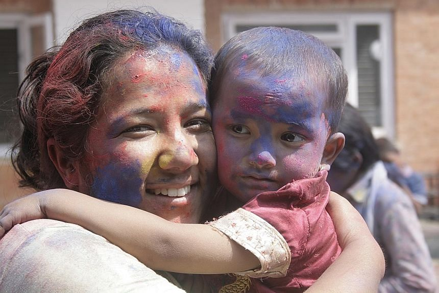 Nepalese social worker Pushpa Basnet (left) houses, feeds and sends children of prisoners to school.
