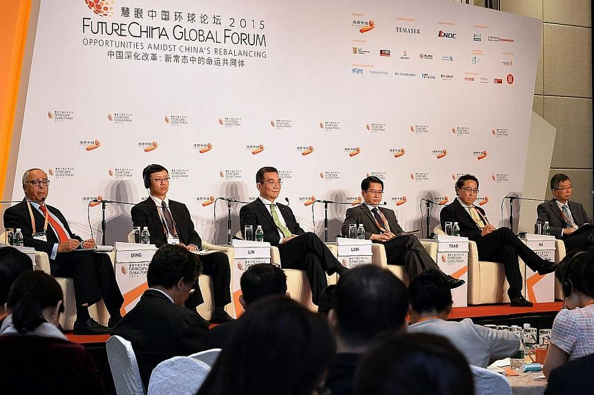 "The FutureChina Global Forum yesterday discussed the impact of China's ""One Belt, One Road"" initiative. Members of the panel were (from left) Mr Claude Smadja (moderator), Mr Ding Hong Bin, Professor Justin Lin, Mr Stanley Loh, Mr Frederick Tsao and"