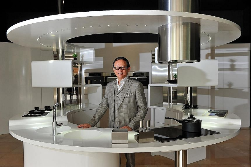 Luxx Newhouse Group president Jimmy Tong, 62, with the Acropolis kitchen design, which won the SG Mark Gold Award. The company specialises in the design, fabrication, contract management and distribution of solid-surface materials.