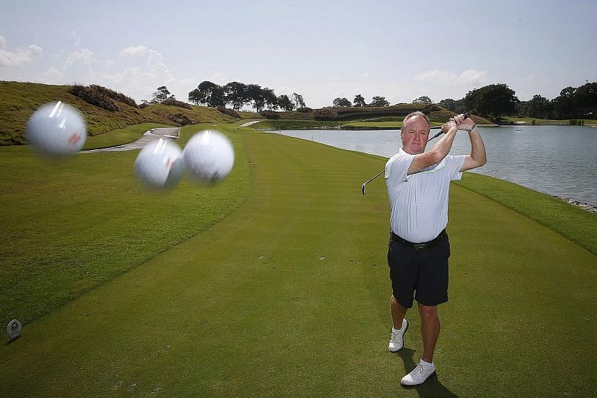 Allan Muir with his three hole-in-one balls at the Laguna National Golf and Country Club, where he has hit two of his three aces since June 4.