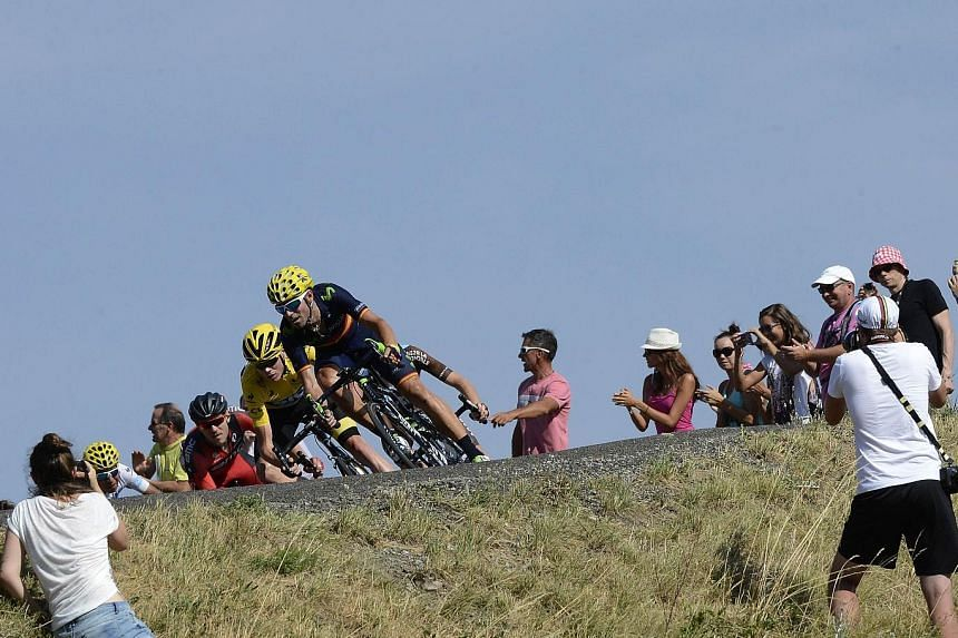 Chris Froome, wearing the overall leader's yellow jersey, in action during the 201km 16th stage of the Tour de France on Monday. He finished 28th, more than 18 minutes behind winner Ruben Plaza, but still had to answer doping-related questions.