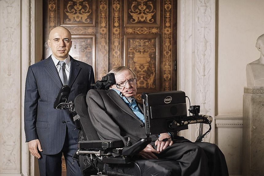 Entrepreneur Yuri Milner (left, with Prof Hawking) believes other civilisations can teach humans how to handle challenges.
