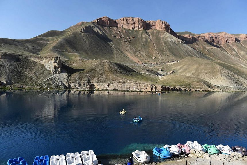 Afghan visitors as they use a paddle-boat on Band-i-Amir Lake in the central Afghan province of Bamiyan.