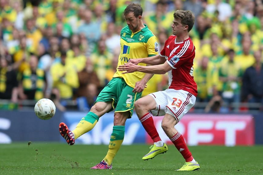 Patrick Bamford (right)  in action for Middlesbrough against Norwich City's Steven Whittaker.