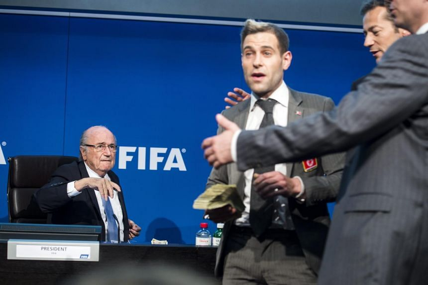 Fifa president Sepp Blatter (left) reacts next to British comedian Simon Brodkin (centre).