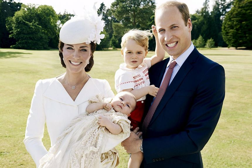 Britain's Prince William (right) and Catherine (left), the Duchess of Cambridge, with their children, Prince George (second right) and Princess Charlotte, who was christened at Sandringham, are seen in this handout photograph released on July 9, 2015