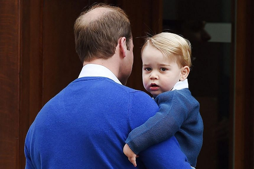 A file photograph dated on May 2, 2015 of Britain's Prince William (left), Duke of Cambridge, arriving with his son Prince George at the Lindo Wing to visit his wife, the Duchess of Cambridge, and newborn daughter at St. Mary's Hospital in Paddington