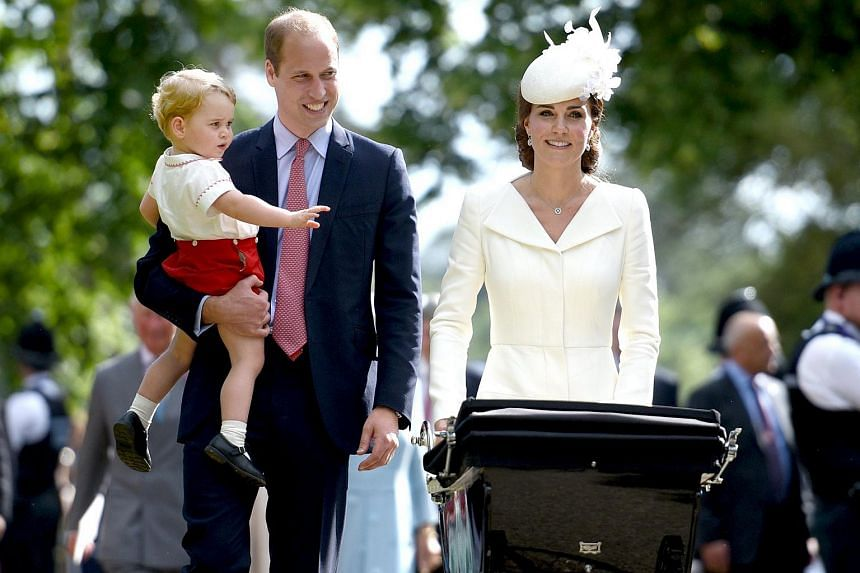 The Duke and Duchess of Cambridge walk past the crowds at the Church of St Mary Magdalene on the Sandringham Estate with their son Prince George (left) and daughter Princess Charlotte (in pram), after her christening, on July 5 2015.