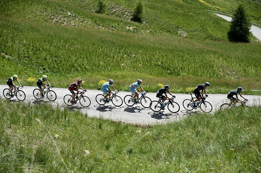 Cyclists at the Allos hill (col d'Allos). Riders drop more than a vertical kilometre in under 15 minutes during the 15.9km descent.