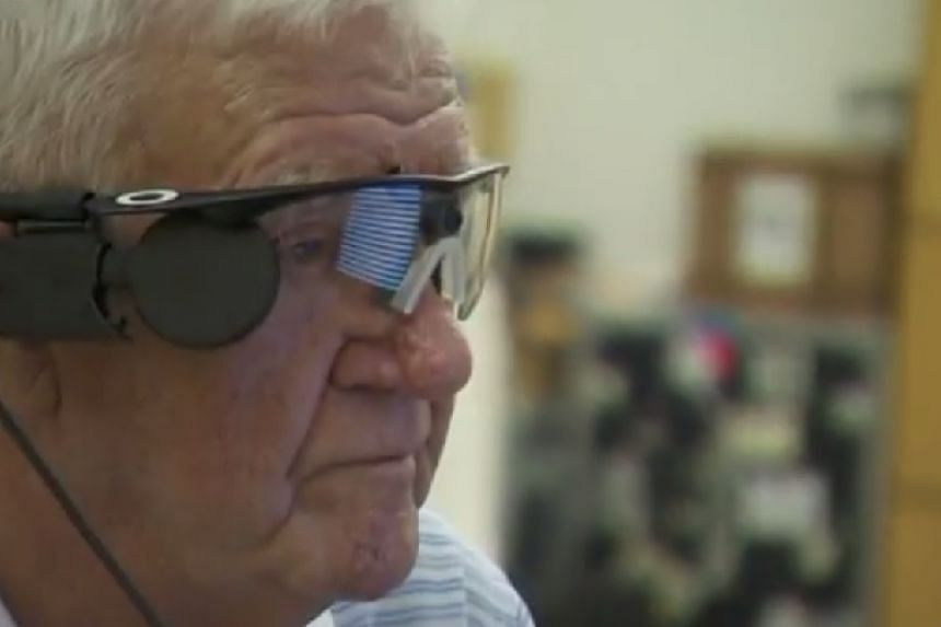 Mr Flynn, wearing glasses featuring a video camera that sends signals to his retinal implant.