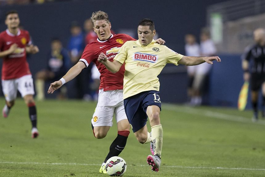 Bastian Schweinsteiger (left) fighting for the ball with Club America's Pablo Cesar Aguilar in Seattle.
