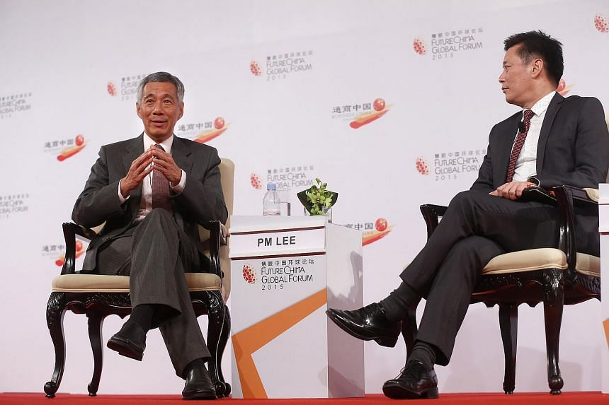 Minister Lee Hsien Loong participating in a dialogue session, moderated by Lianhe Zaobao editor Goh Sin Teck, of the Future China Global Forum at Shangri-La Hotel on July 21, 2015.
