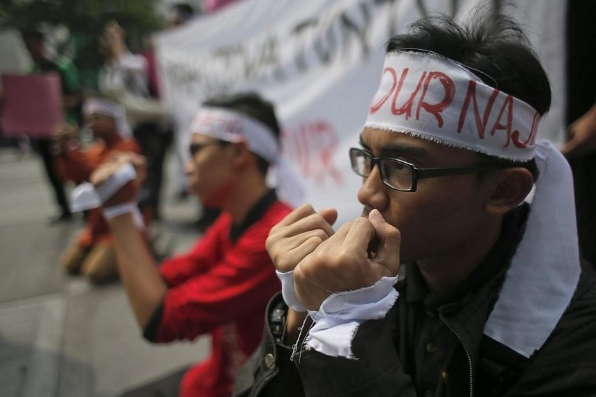 Student protesters take part in a demonstration against Malaysian Prime Minister Najib Razak allegedly having received millions of dollars in his personal accounts from a state fund, and call for him to step down.