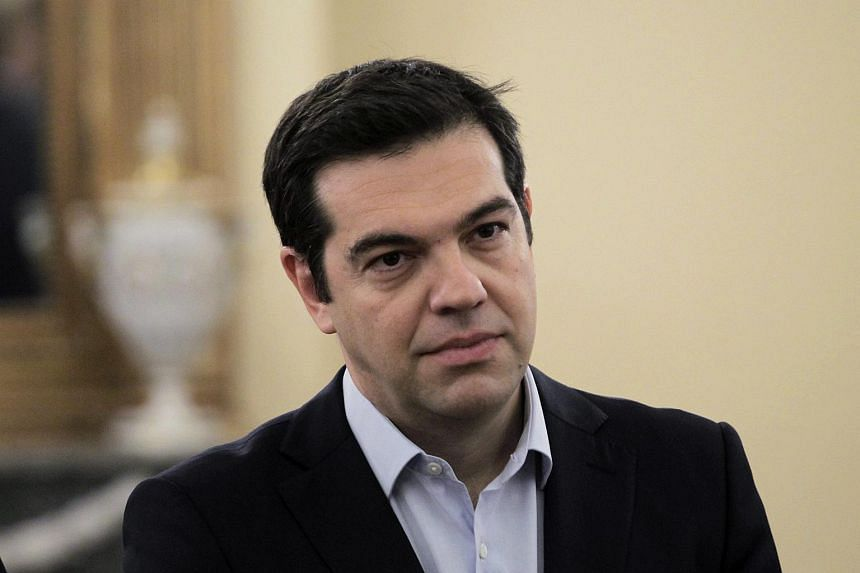Greek Prime Minister Alexis Tsipras looks on as designate ministers are sworn in at the Presidential Mansion in Athens, Greece, on July 18, 2015.