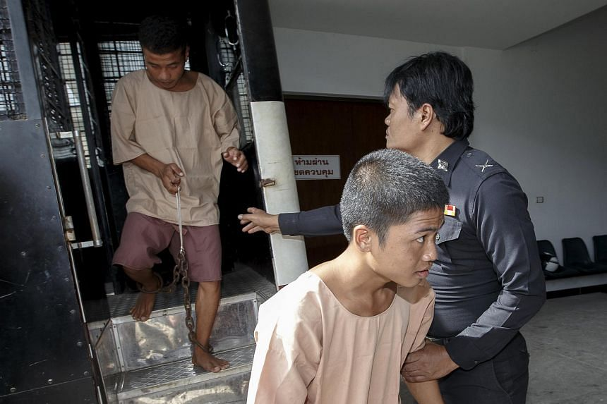 Myanmar migrant workers Zaw Lin (right) and Win Zaw Htun arrive at the Koh Samui Provincial Court, in Koh Samui, Thailand.