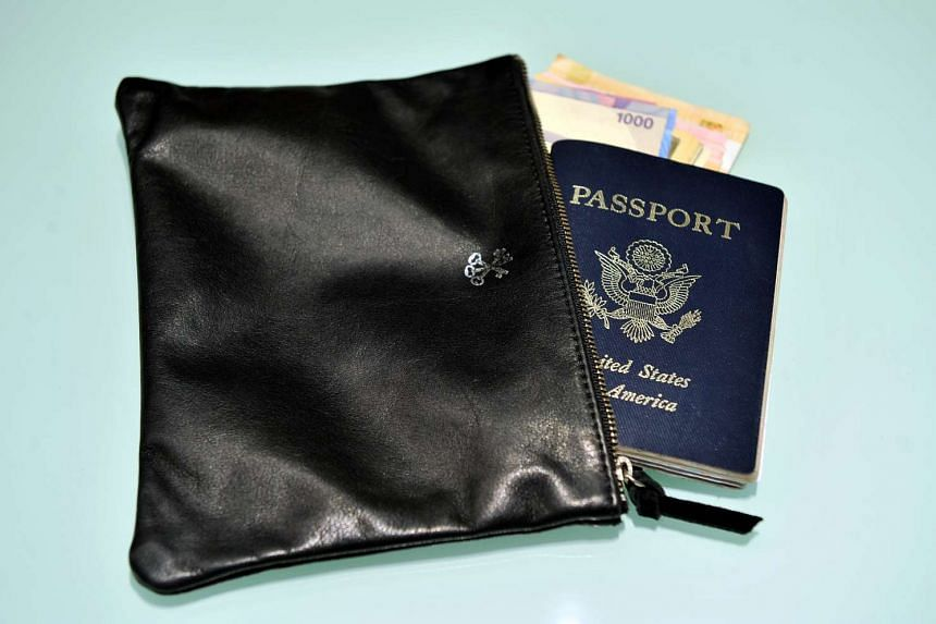 A travel pouch containing a US passport.