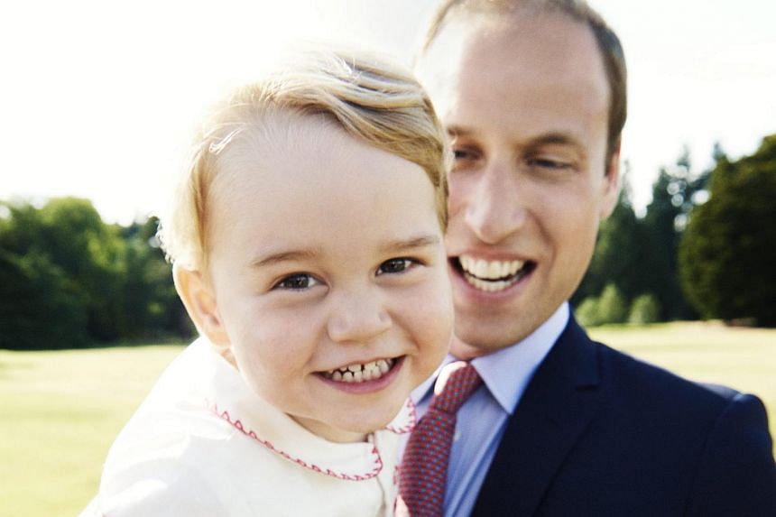 Prince William, The Duke of Cambridge, carrying his son Prince George during the christening of his baby daughter Princess Charlotte, in Sandringham, Norfolk, Britain.