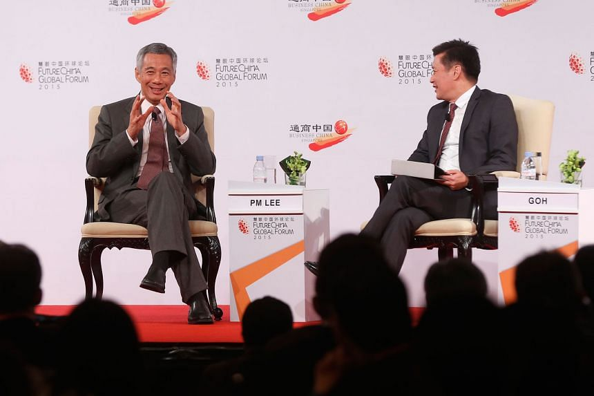 Prime Minister Lee Hsien Loong speaking at the dialogue, moderated by Lianhe Zaobao editor Goh Sin Teck, at the FutureChina Global Forum at Shangri-La Hotel yesterday. The wide-ranging dialogue spanned issues such as immigration, entrepreneurship, te