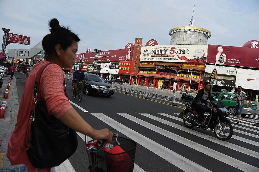 The main shopping street in Hunchun, in China's north-eastern Jilin province. The nondescript town is at the heart of Beijing's plans to revitalise its north-eastern rust belt.