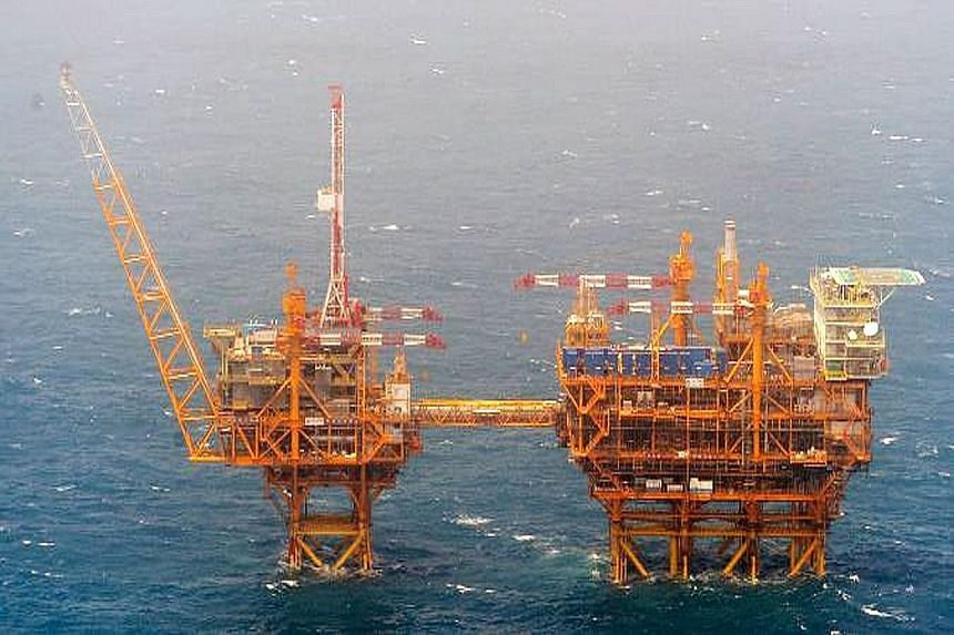 A picture released by Japan's Defence Ministry yesterday shows two Chinese- built platforms, one (left) which was observed in June last year and the other in March this year, in disputed waters. Chinese Foreign Ministry spokesman Lu Kang said Tokyo's