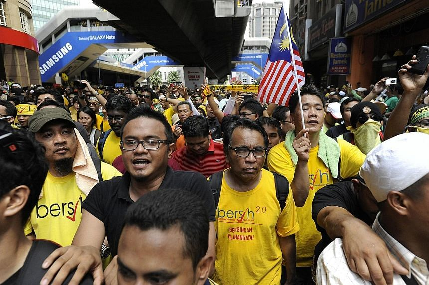 Protesters at a Bersih rally in Kuala Lumpur in 2012. The political activist group is one of the partners named by Anwar, who is in jail, for the upcoming opposition alliance.