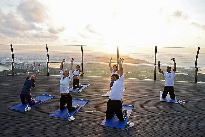 Simona Halep (second from left) is here to help launch this year's BNP Paribas WTA Finals Singapore. Yesterday, she participated in a sunrise yoga session at the Marina Bay Sands Observation Deck.