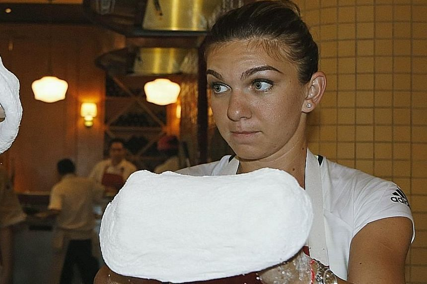 Topping off her talents, Simona Halep learns how to stretch pizza dough at the Shoppes at Marina Bay Sands yesterday.