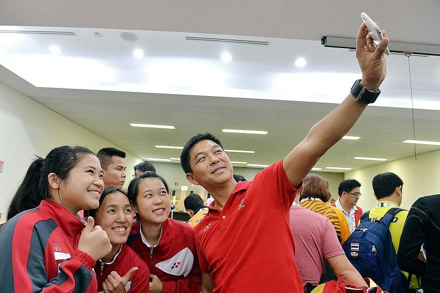 Mr Tan Chuan-Jin taking a wefie with Singapore's SEA Games 10m air rifle team gold medallists (from left) Martina Veloso, Jasmine Ser and Tessa Neo.