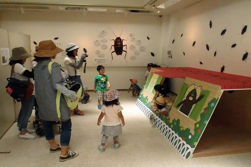 Visitors can have fun at a playhouse in the shape of a roach trap at the cockroach exhibition at Tokuyama Zoo in Japan.