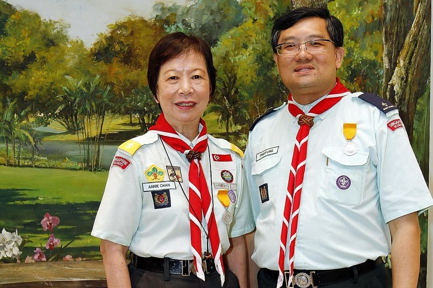 Teacher Annie Chan and auditor Philip Ling were among 35 adult scout leaders to receive Distinguished Service Awards at the Istana yesterday. The annual scout awards were handed out by President Tony Tan Keng Yam, who is also Chief Scout. Mrs Chan, 6