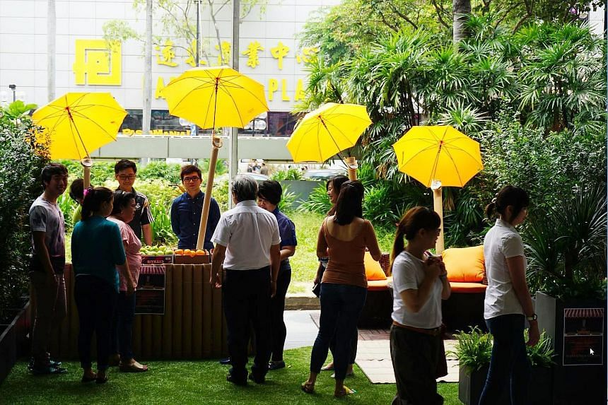 """One of last year's PARK(ing) Day initiatives was this """"marketplace meets garden"""" set up in parking spaces at Scotts Road."""