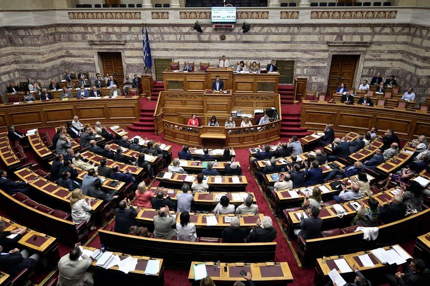 Greek Prime Minister Alexis Tsipras addresses a session at the Greek parliament on July 23, 2015.